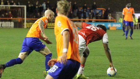 Sean Clohessy, left, in action for Braintree against Woking last night. Chris Arthur is on the ball