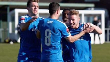 Leiston's Conor Hubble, right, celebrates with team-mates after putting his team ahead on Saturday