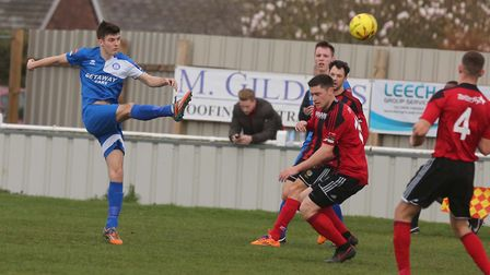 Bury Town, in blue, in action. Stock image. Pictue: Seana Hughes