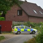 Police search fields near the home of Peter and Sylvia Stuart in Weybread, after their disapperance.