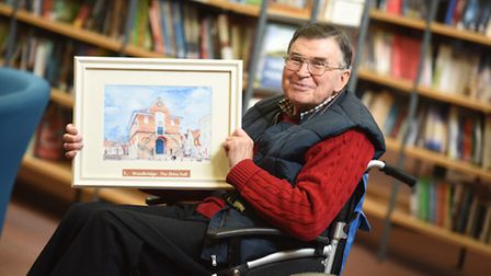 Artist Tom Ambridge with one of his paintings on show at Woodbridge Library. Picture: GREGG BROWN