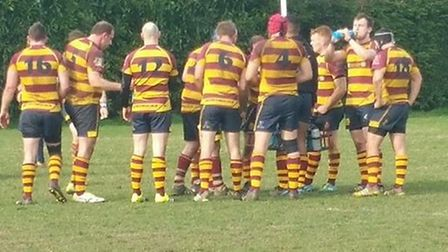 Ipswich YM players take a break during their victory on Saturday. Photo: DICK WATSON