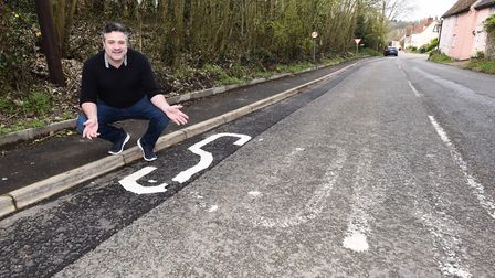 Picture of Will Chaytor from CoffeeBox with the road sign. Picture: GREGG BROWN