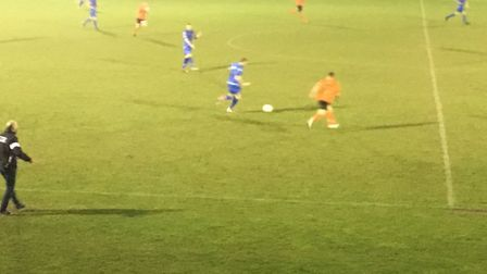 Action from Bury Town's match at Aveley tonight, with manager Ben Chenery urging on his side from th