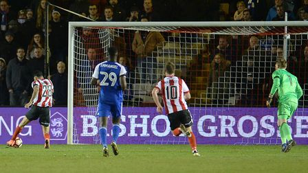 Lincoln's Nathan Arnold scores the last-gasp winner for the non-league side, against Ipswich.