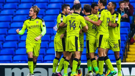 Rotherham United's Danny Ward (left) punches the air, as his teammates celebrate his second goal to