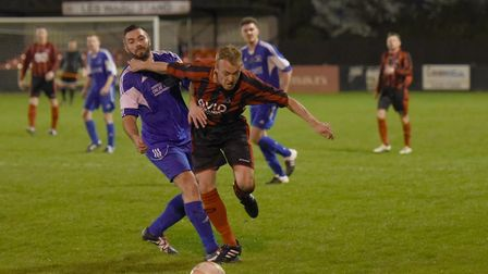 Achilles' Joe Revell (right) tussles with Capel Plough's Chris Wall.