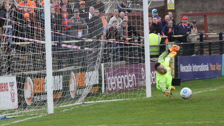 Braintree fans look on as York keeper Loach makes a great save from Chez Isaac's free kick