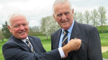 New Suffolk Golf Union president Colin Firman (right) receives the badge of office from past preside