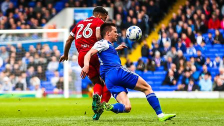 Jonas Knudsen battles to stay on his feet as he is challenged by David Davis on Saturday. Picture: S