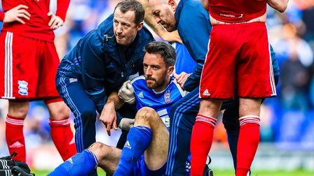 Cole Skuse is helped up after taking a knock late on in the first first half on Saturday. Picture: S