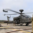 Chinook crews pick up underslung loads at Woodbridge Airfield and refuel, alongside Apache helicopte