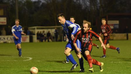Achilles' Lee Grimwood (right) battles with Capel Plough's Matthew Easton during last week's Suffolk