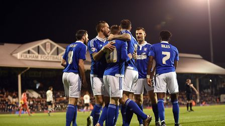 Freddie Sears is congratulated after scoring inside the opening minute at Craven Cottage last season