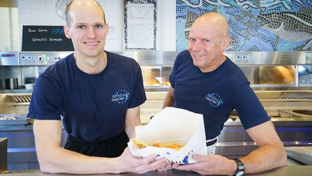 Alan Cooney (left) with his father Peter (right), owners of the Aldeburgh Fish and Chip shop. Pictur