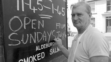 Horace Cooney at Aldeburgh Fish and Chip shop writing up new opening times for Sundays back in 1982