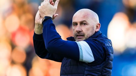 Colchester United boss John McGreal salutes the home crowd after the U's 2-1 win over Luton Town in
