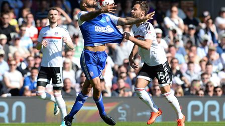 David McGoldrick gets his shirt tugged by Fulham's Michael Madl whilst controlling the ball during t