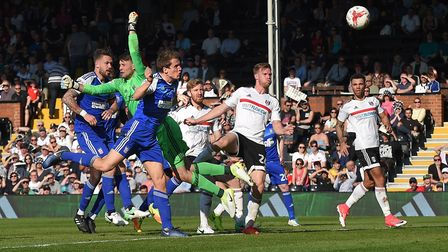 Christophe Berra gets to the ball first to head a late consolation goal against Fulham at Craven Cot