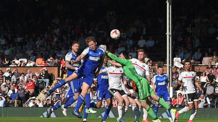 Christophe Berra heads a consolation goal against Fulham at Craven Cottage