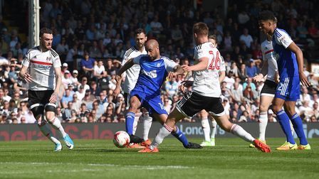 David McGoldrick hits the ball with the outside of his boot against the Fulham post late in the firs