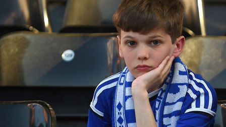 One young Town fan after the defeat at Craven Cottage