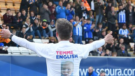 Colchester United fans applaud the fund-raising exploits of Tommy Leggett, after his 46-mile run fro