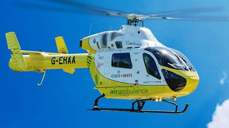 Stock image of Essex and Herts Air Ambulance (EHAAT) in flight