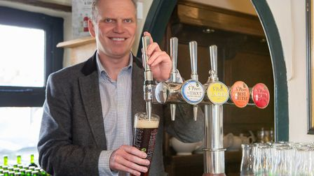 Steve Magnall, chief executive at St Peter's Brewery pouring some draught Without alcohol-free beer.