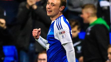 Freddie Sears celebrates his second goal and Town's third in the 3-0 win over Wigan. Photo: Steve Wa