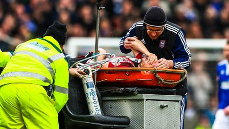 Alan Judge receives attention following his injury at Portman Road. Picture: Steve Waller