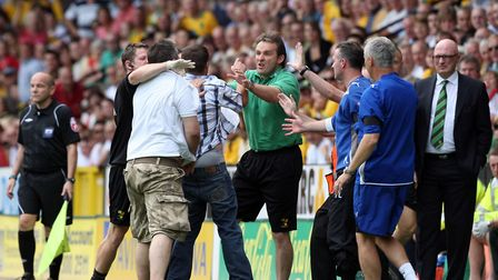 A Norwich City fan throws his season ticket towards the manager Bryan Gunn during the Canaries' 7-1