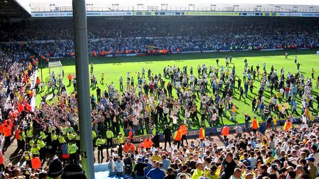 Leeds United fans invade the pitch after Ipswich Town's late leveller virtually sealed their relegat