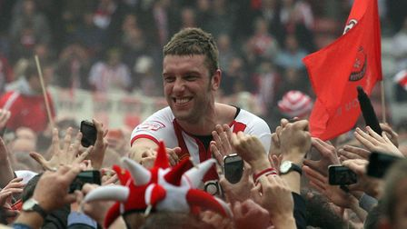 Southampton's Rickie Lambert is carried off the pitch by jubilant fans following the club's promotio