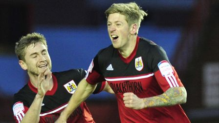 Jon Stead (right), who is set to lead Notts Country's front-line alongside Shola Ameobi against Colc
