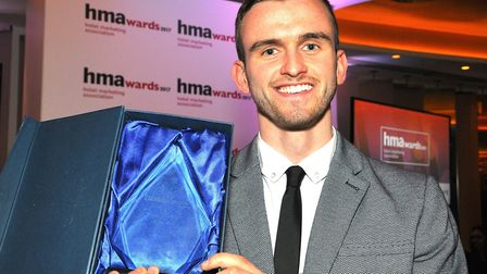 Tom Driscoll with his Young Marketer of the Year trophy at the Hotel Marketing Awards