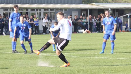 Crane Sports captain Mark Roper scores from the penalty spot to make it 2-0 in his side's 4-1 victor