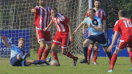 Godmanchester claim for a penalty as Sheridan Driver clears for the Seasiders