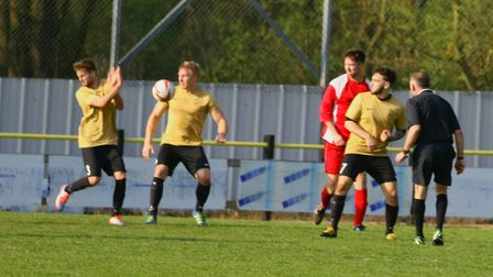 Ben Licence appears to handle the ball for Stowmarket late on
