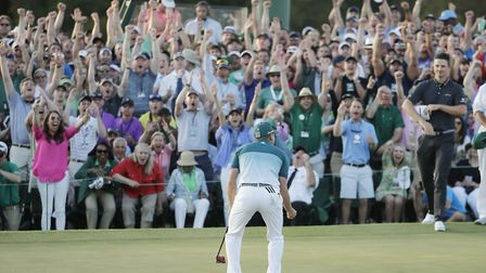 Justin Rose, of England, right, watches as Sergio Garcia, of Spain, reacts after making his birdie p