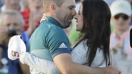 Sergio Garcia, of Spain, reacts with his fiancee Angela Atkins on the 18th hole after a playoff at t