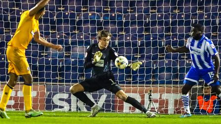 U's keeper Sam Walker, making a fine save during the home win over Mansfield last month. The U's ent