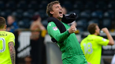 Sam Walker, in a celebratory mood, is confident that the U's can maintain their play-off push. Pictu