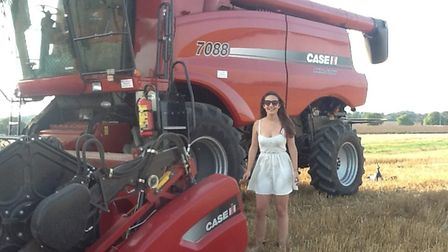 Lucy McVeigh of Kenton Hall Estate with her Case Combine Harvester 7088.