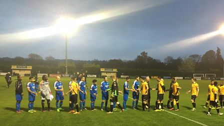 The two teams before kick-off at Merstham tonight, Leiston in the blue shirts
