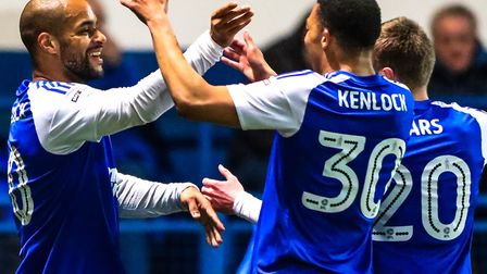 All smiles! David McGoldrick celebrates with Myles Kenlock and Freddie Sears after opening the scori