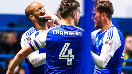 David McGoldrick celebrates his goal against Wigan with Luke Chambers and Emyr Huws. Picture: STEVE
