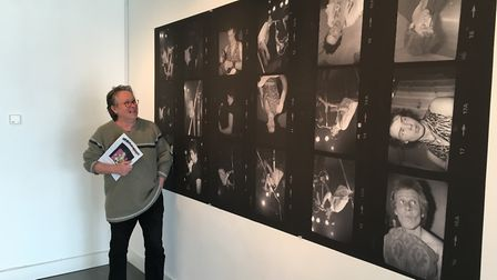 Eddie Duggan with blown up contact prints of the first Sex Pistols gig which is part of the birth of