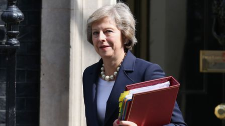 Prime Minister Theresa outside 10 Downing Street, London. Photo: Philip Toscano/PA Wire