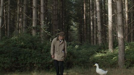 A still from the filming of Eat Your Principles, featuring protagonist Phil Fuller and his duck foll